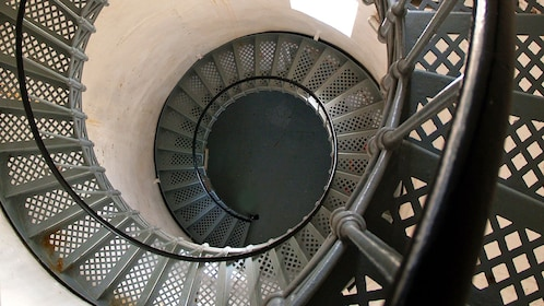 looking down a spiral staircase inside the lighthouse in Australia