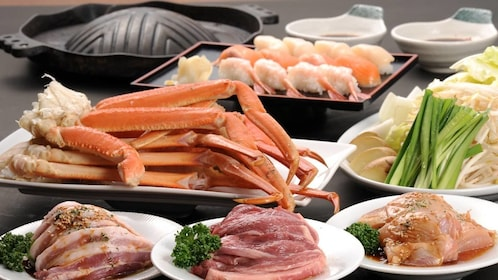 Variety of seafood and meats at the buffet in Tokyo