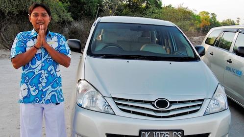 driver posing near car in bali