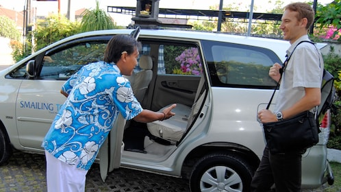 driver opening door for passenger in bali