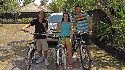 people with bicycles in bali