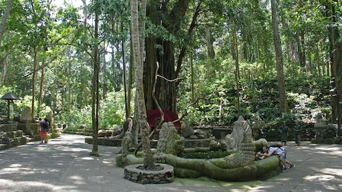 statues in forest in bali