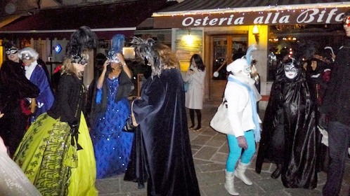 Street view of tour group on the carnival pub crawl tour in Venice