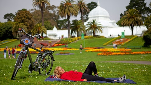 Woman lying on grass in San Francisco park