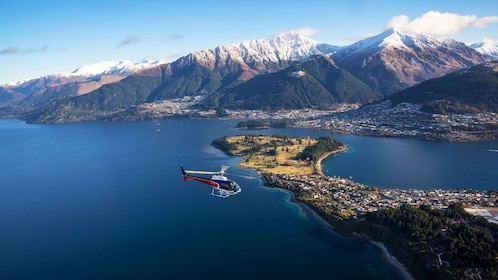 Helicopter flying over Queenstown and Lake Wakatipu in New Zealand