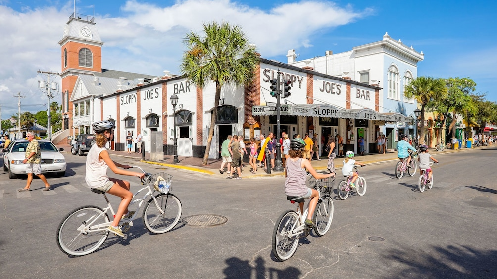 Show item 1 of 9. Riding bikes near a bar in Miami