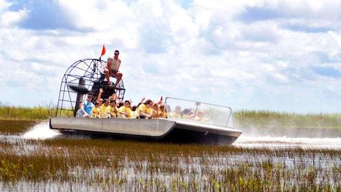 Airboat speeding through the everglades in Florida