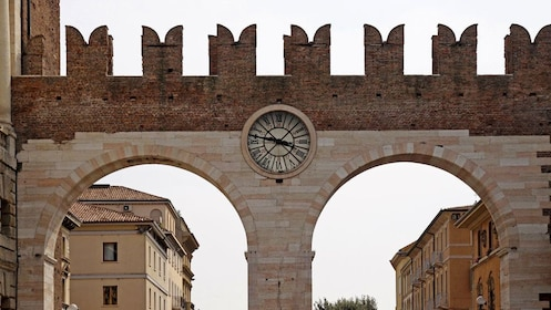 Arch gateway and clock in Verona