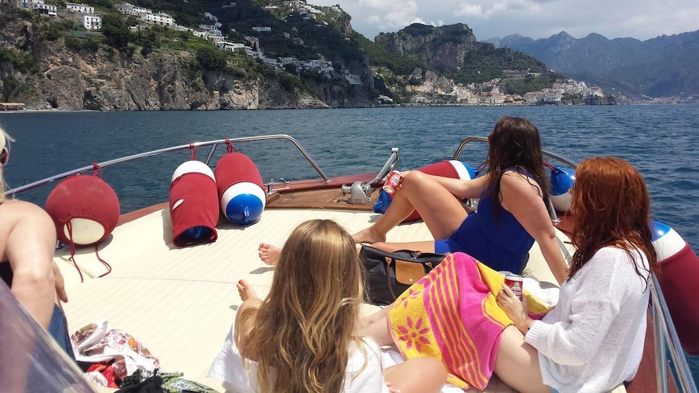 Apri foto 1 di 9. women on boat basking in the sun in Italy