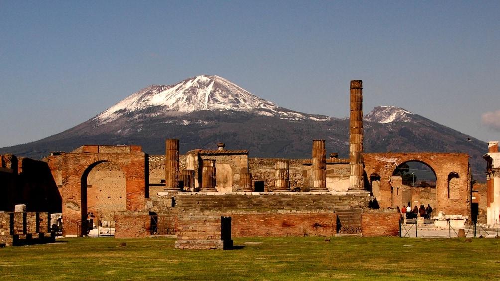 Apri foto 4 di 8. The ruins of Pompeii with a snowcapped Vesuvius in the background