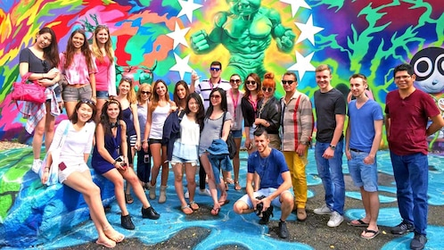 group standing in front of vibrant street art in Miami