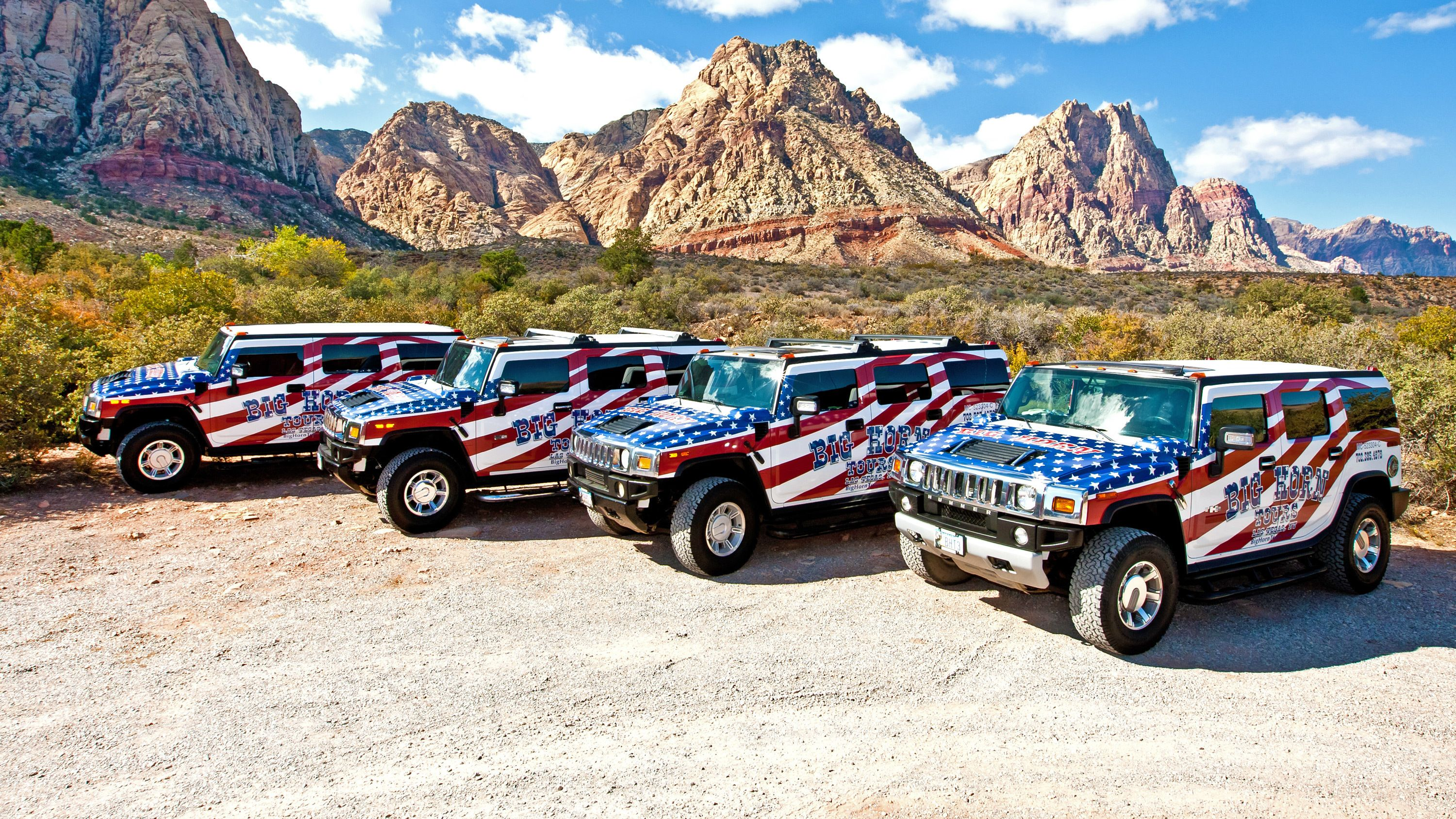 Hummer vehicles covered in patriotic themed decals in Las Vegas