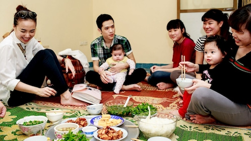A Hanoi family with bowls of food.