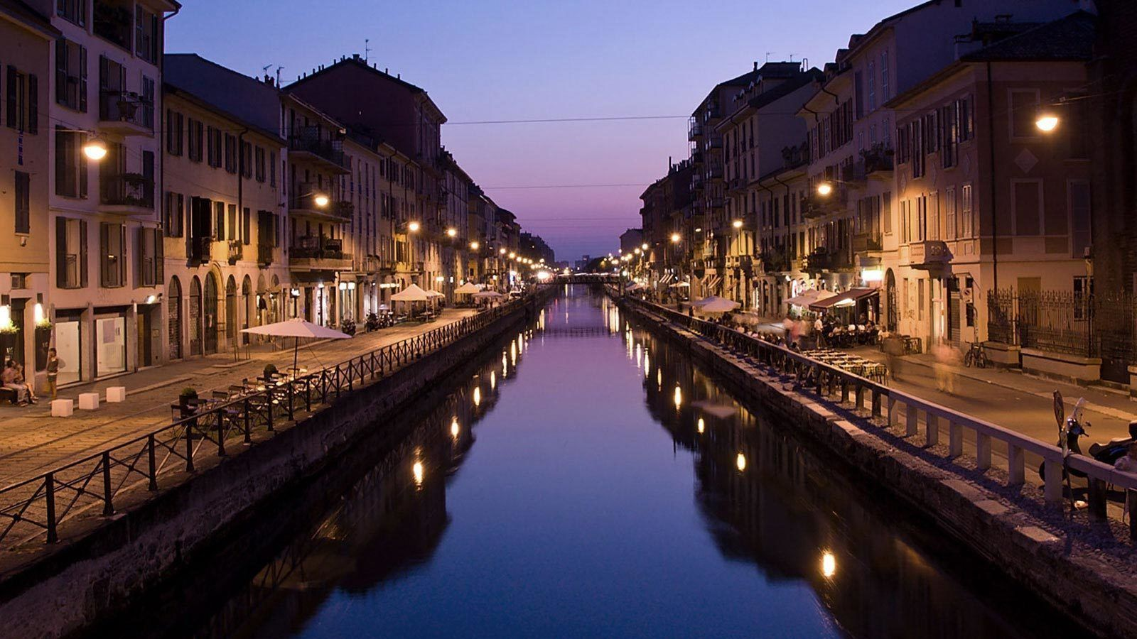 city lights along the water channel in Italy