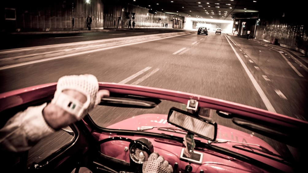 Show item 1 of 5. driving a small Fiat car with the top down in Italy