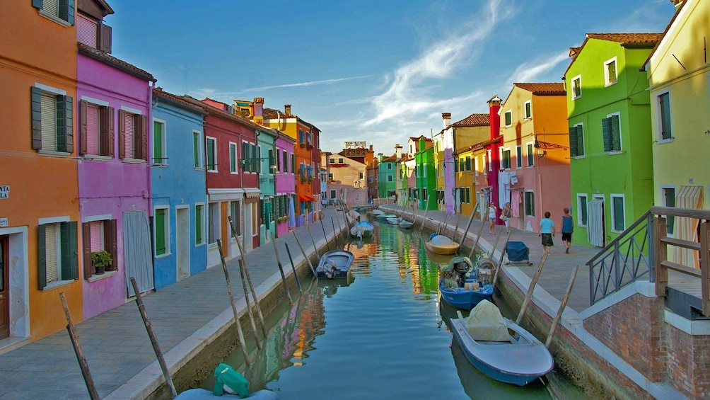 Show item 1 of 10. Multi-colored buildings split by a canal in Venice, Italy
