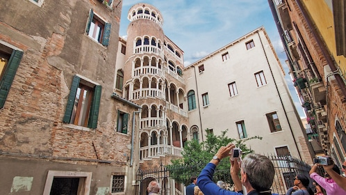 people taking pictures of interesting architecture