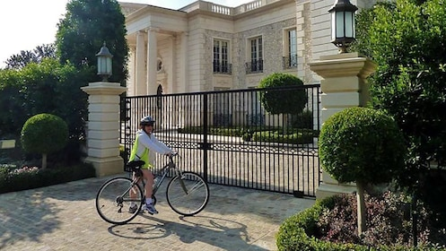 Cyclist in front of gate with bike.