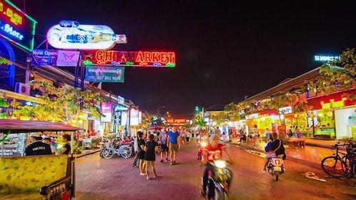 Street view of illuminated night market in Angkor.