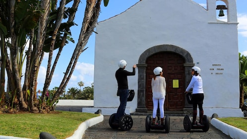 Segway riding group outside a chapel in Tenerife