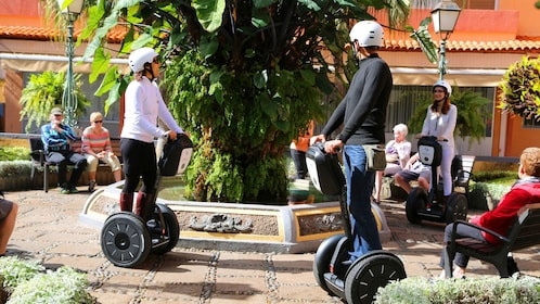 Segway riding group near a fountain in Teneriife