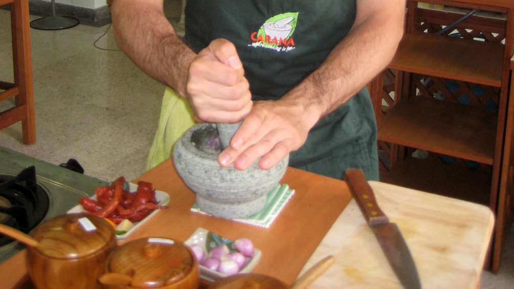Show item 4 of 5. person using mortar and pestle in Kuala Lumpur