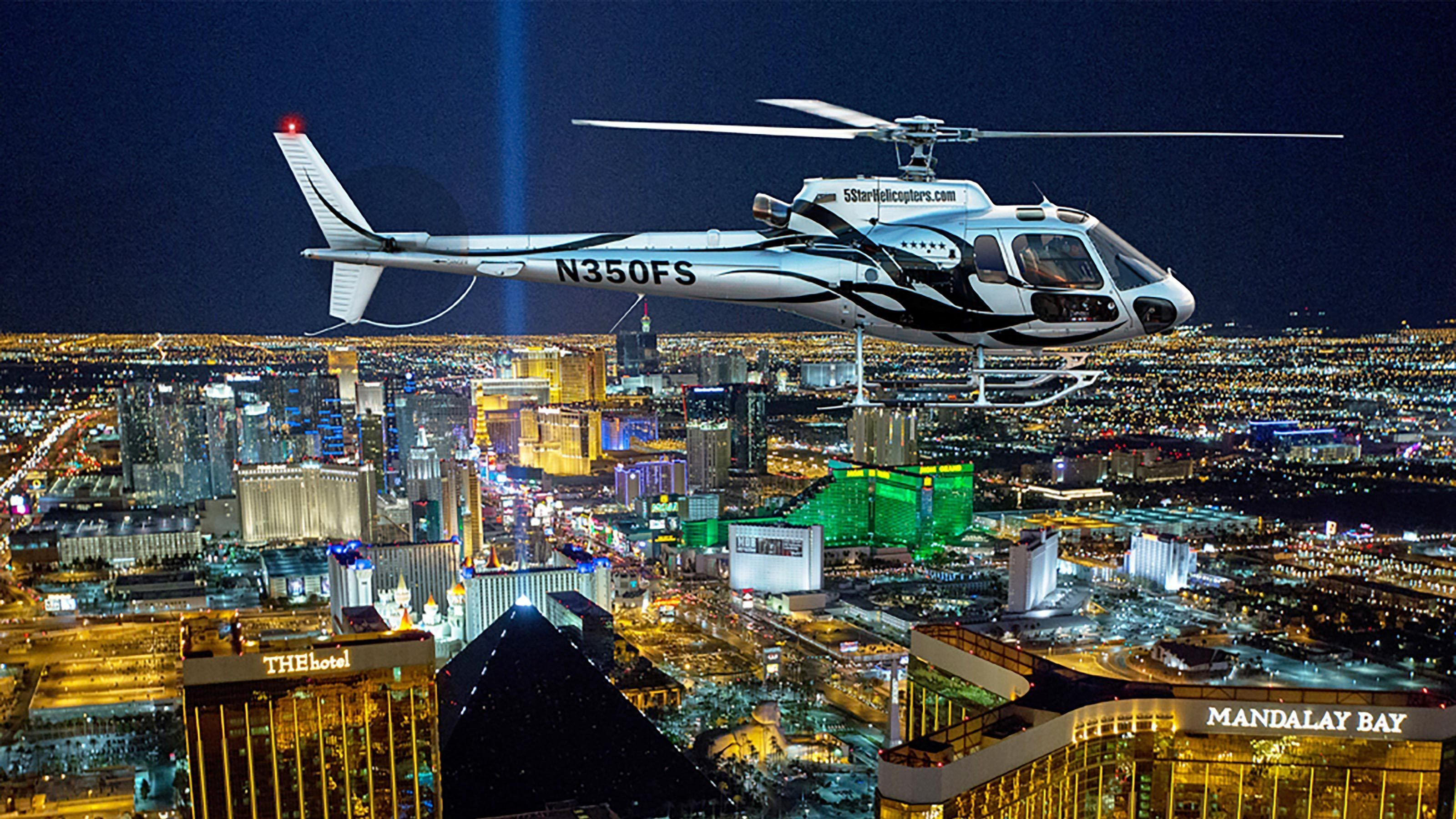 Helicopter flying over Las Vegas at night