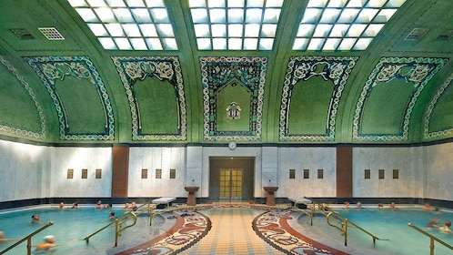 Two Budapest baths under a tile ceiling