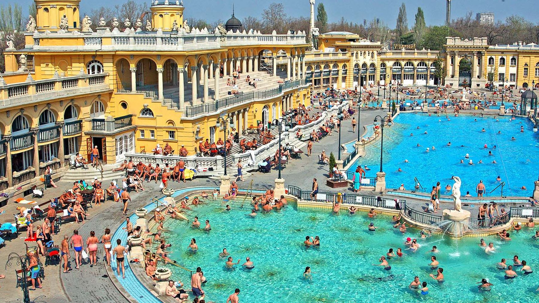 overview of expansive pools filled with people