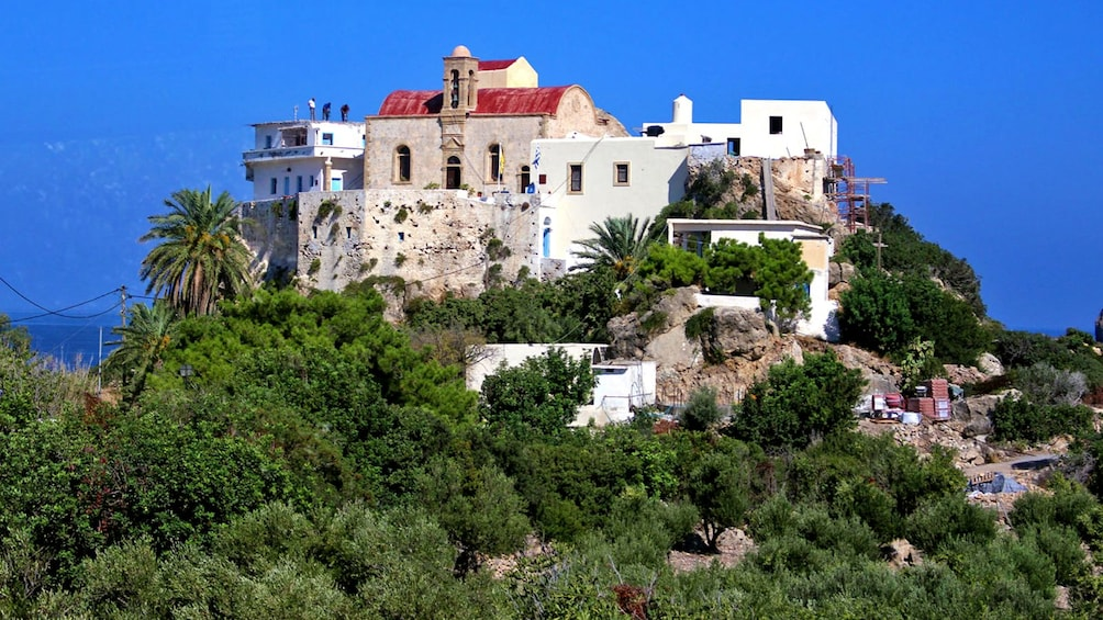 old building on top of a steep hill in Greece