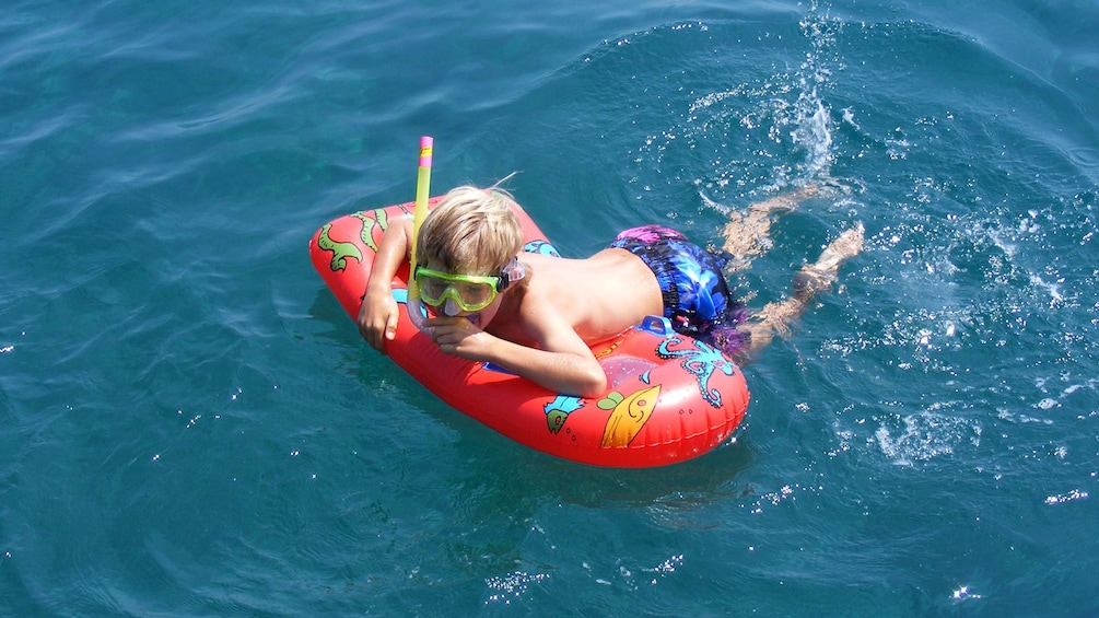 Show item 2 of 10. Young boy snorkeling in Crete Island