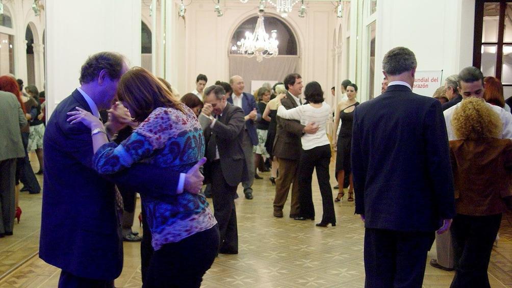 Tango class in a ballroom in Argentina