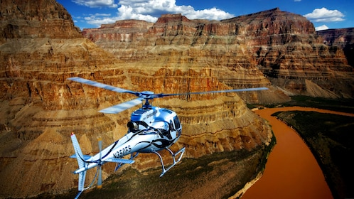 Helicopter hovers over the river in the Grand Canyon