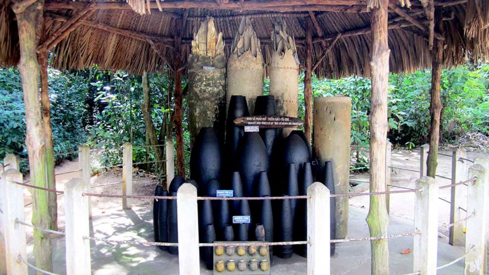 Show item 3 of 8. An outdoor exhibit of artillery used in the Vietnam war. Shells of various size.