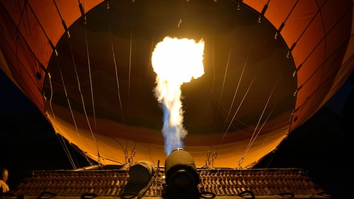 The flame at the base of a hot air balloon.