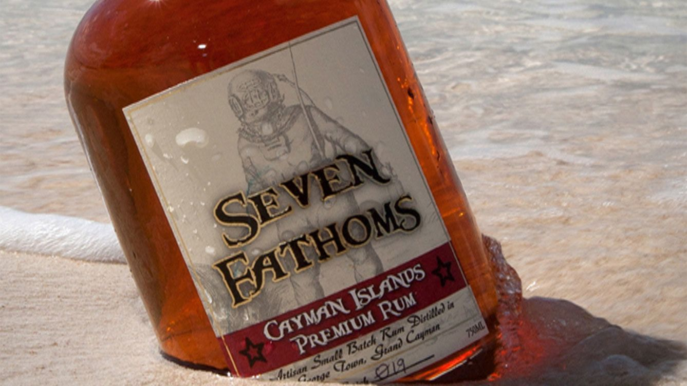 Bottle of rum on the beach in Cayman Islands