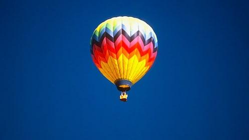 A hot air balloon in the blue sky