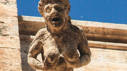 Close up of ancient sculpture on building.