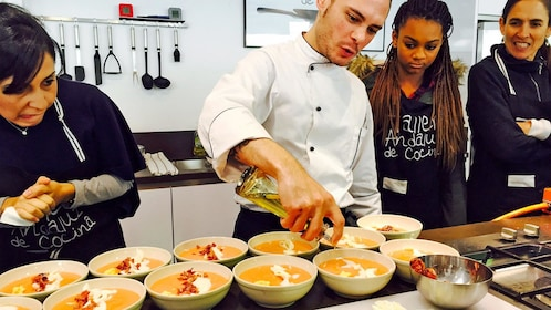 Instructor leading the Spanish Cooking Class in Seville, Spain