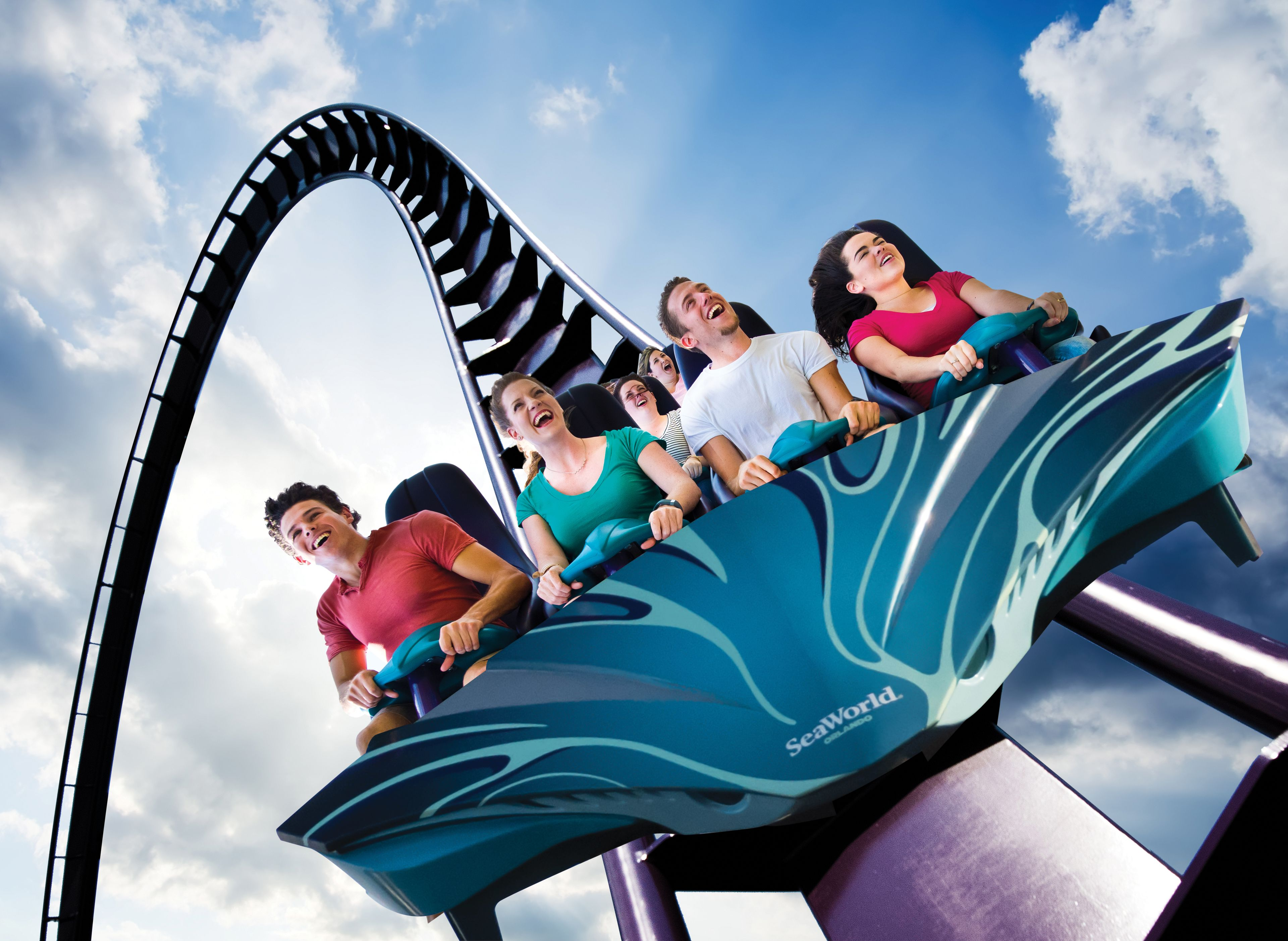 Group of People ride a roller coaster at Aquatica