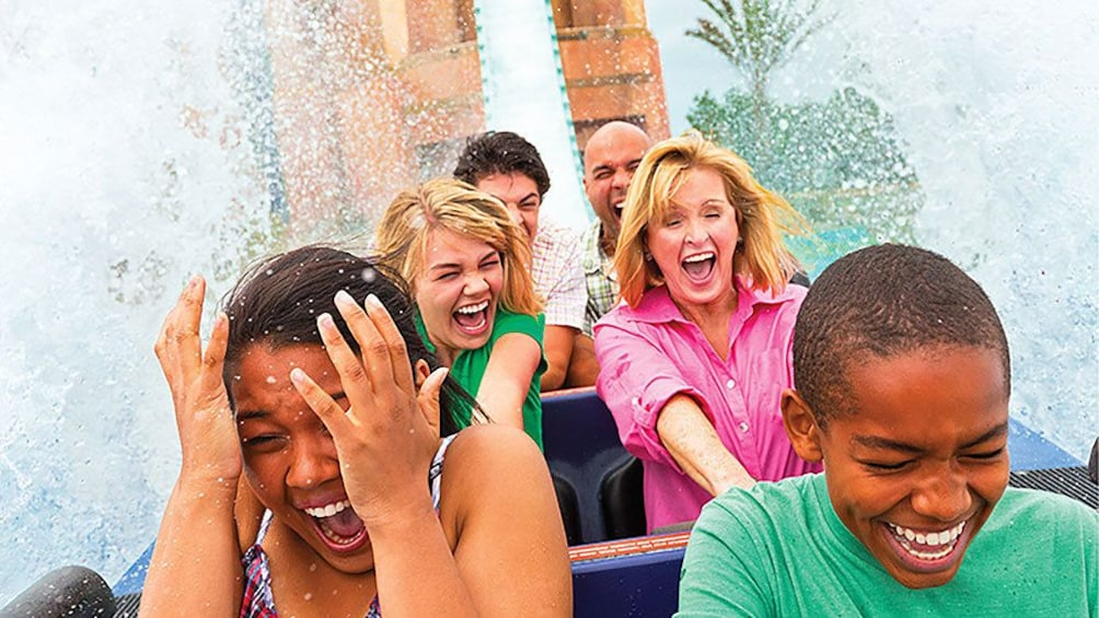 People being splashed by water during ride in Orlando