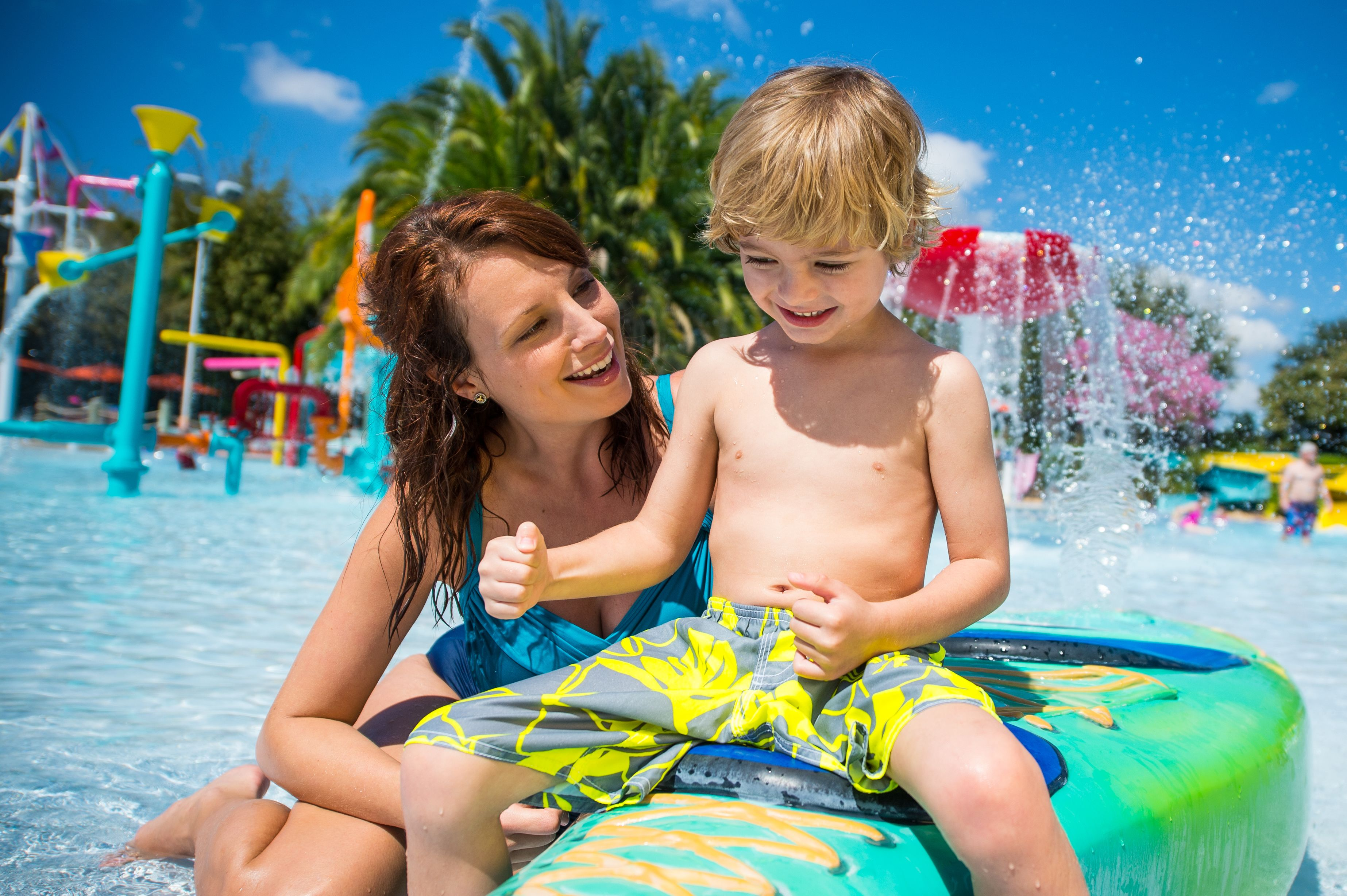 Young boy and woman at the wadding pool at Aquatica