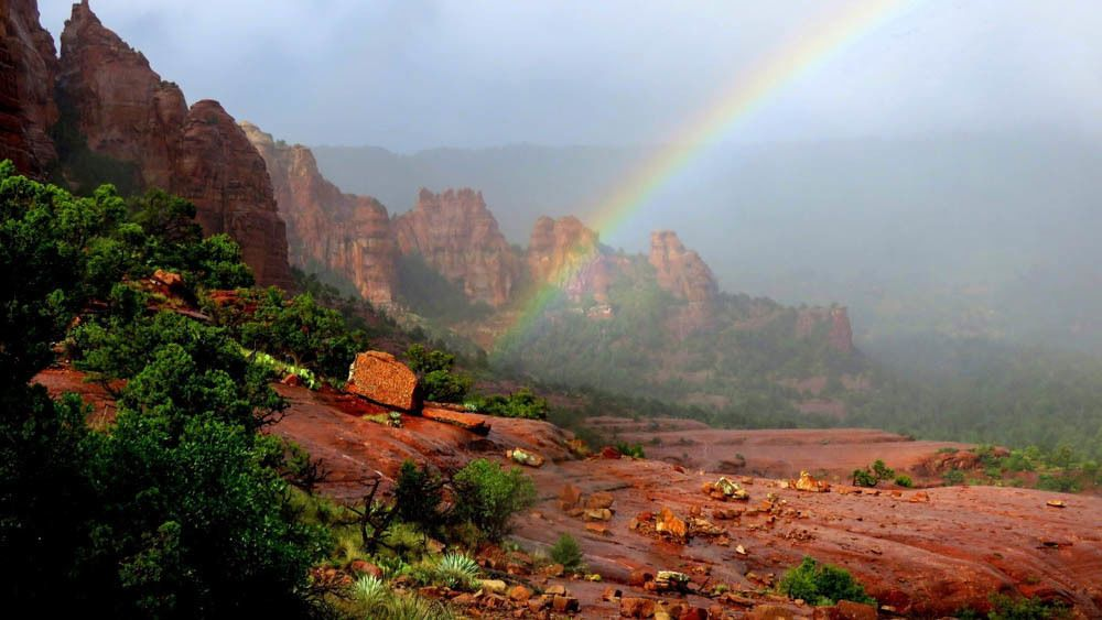 Landscape view of Munds Wagon Trail with vibrant rainbow.