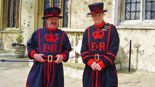 men in Beefeater apparel guarding the tower of london