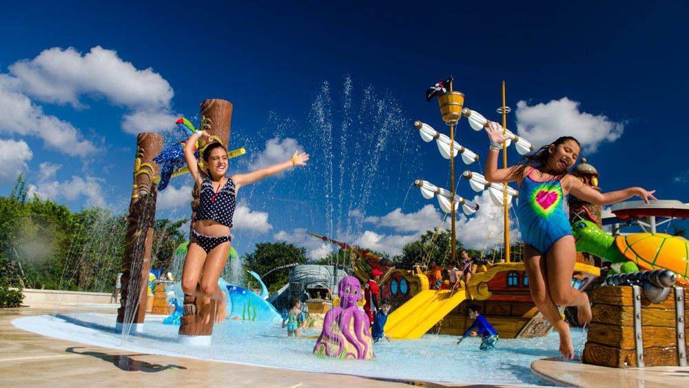 Group of children having fun at water park.