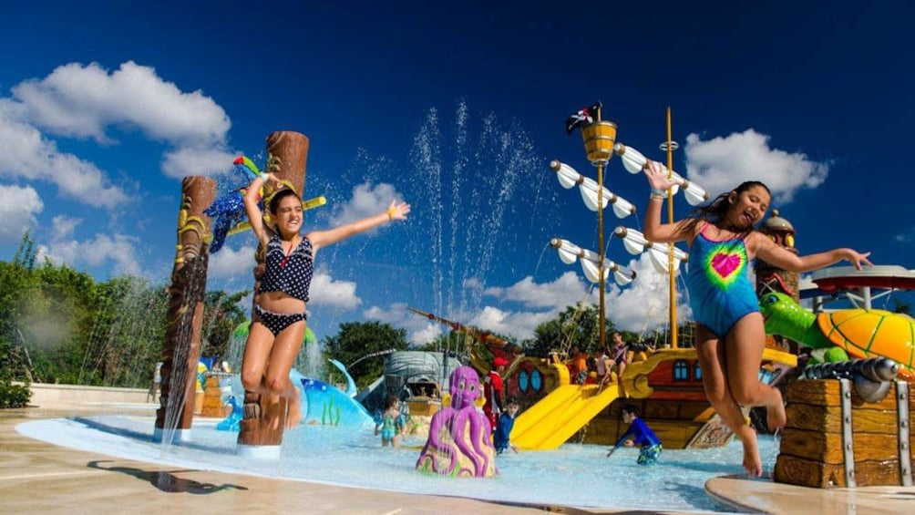 Show item 2 of 5. Group of children having fun at water park.
