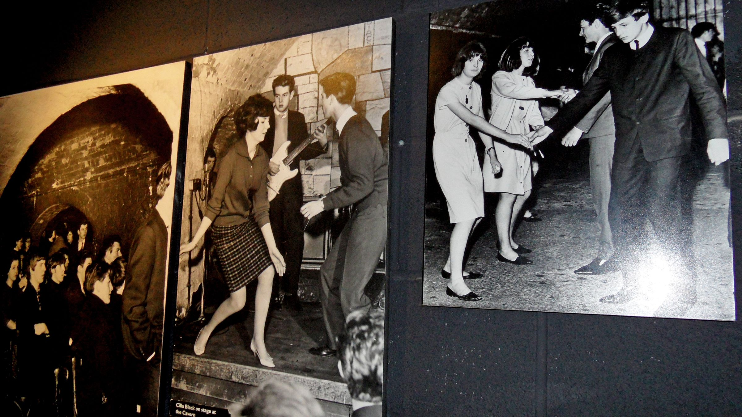 old photography of The Beetles on the wall in London