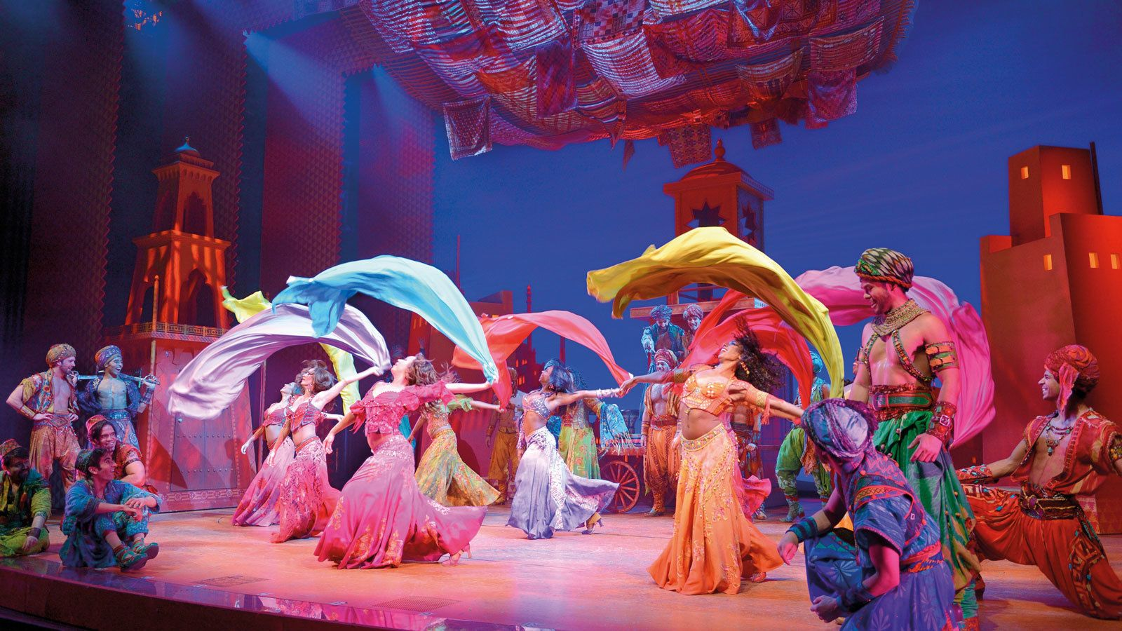 Performers during mid show of Aladdin at Prince Edward Theatre in London