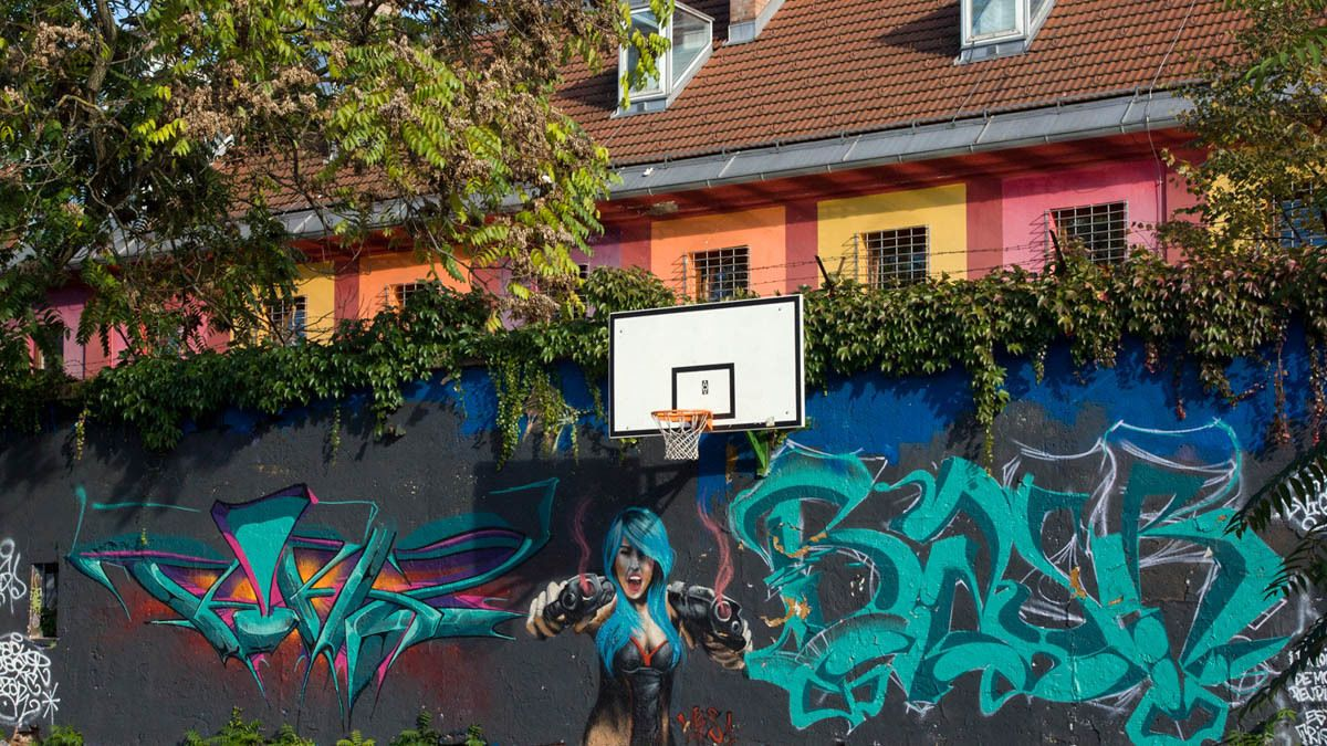 Basketball court with colorful graffiti.