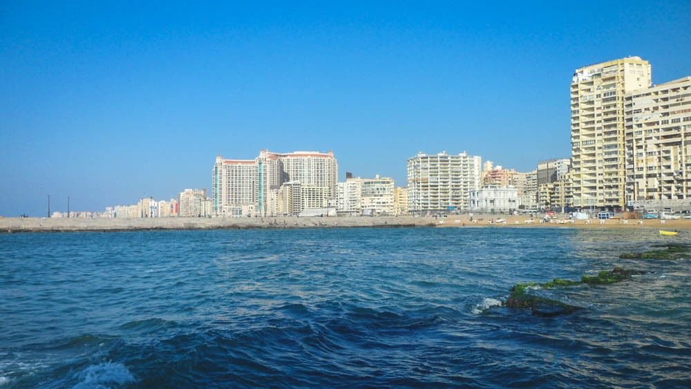 Beach view of the city during the day.